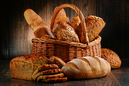 wholemeal: Composition with variety of baking products on wooden table