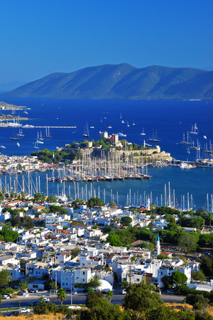 beach scene: View of Bodrum harbor and Castle of St. Peter. Turkish Riviera.