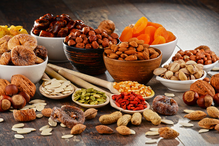 dried: Composition with dried fruits and assorted nuts. Stock Photo