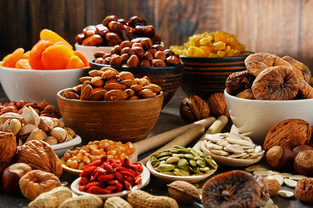 Composition with dried fruits and assorted nuts. 스톡 콘텐츠