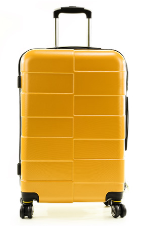 polycarbonate: Large yellow polycarbonate suitcase isolated on white background