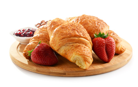 eating pastry: Composition with breakfast on the cutting board isolated on white
