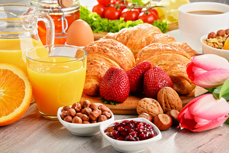 balanced diet: Breakfast consisting of croissants, coffee, fruits, orange juice, coffee and jam. Balanced diet. Stock Photo