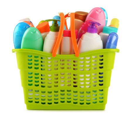 Plastic shopping basket with body care and beauty products isolated on white Stock Photo