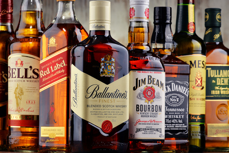 scotish: POZNAN, POLAND - MAY 17, 2016: Whiskey is the most popular liquor in the world. Originated probably in Ireland, now it is produced also in India, Scotland, USA Canada and Japan with over 230 millions of 9 liter cases sold in 2014 Editorial