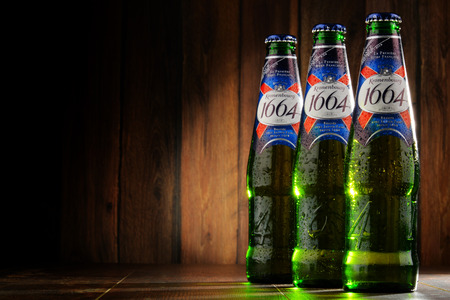 pilsner glass: POZNAN, POLAND - MAY 18, 2016: Kronenbourg 1664, a 5.5% pale lager is the main brand of Kronenbourg Brewery owned by the Carlsberg Group