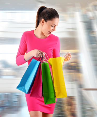 shopping mall: Young woman with bags in shopping mall.