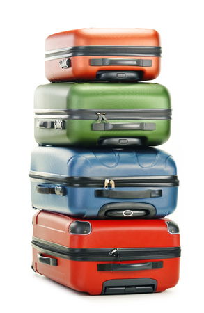 polycarbonate: Luggage consisting of four polycarbonate suitcases isolated on white