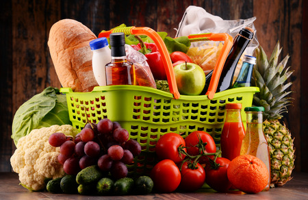 assorted: Plastic shopping basket with assorted gorcery products Stock Photo