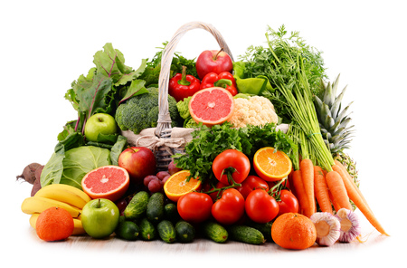 fruits in a basket: Composition with assorted raw organic vegetables. Detox diet