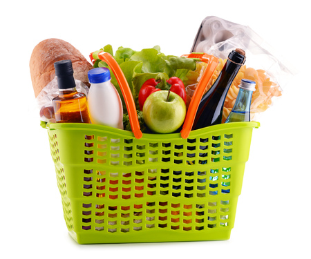 food basket: Plastic shopping basket with assorted gorcery products isolated on white