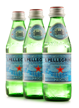 nestle: POZNAN, POLAND - JUNE 24, 2016: San Pellegrino is an Italian brand of mineral water made in the Province of Bergamo, Italy. Owned by Nestle since 1997, it is exported to most countries in Europe, the Americas, Australia and Asia.