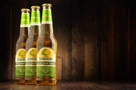 carlsberg: POZNAN, POLAND - JUNE 22, 2016: Somersby cider is a brand of 4.5% abv cider produced by Danish brewing company Carlsberg Group. It is being sold in more than 46 countries.