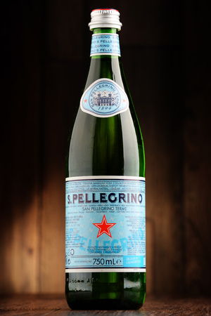 exported: POZNAN, POLAND - JUNE 22, 2016: San Pellegrino is an Italian brand of mineral water made in the Province of Bergamo, Italy. Owned by Nestle since 1997, it is exported to most countries in Europe, the Americas, Australia and Asia. Editorial