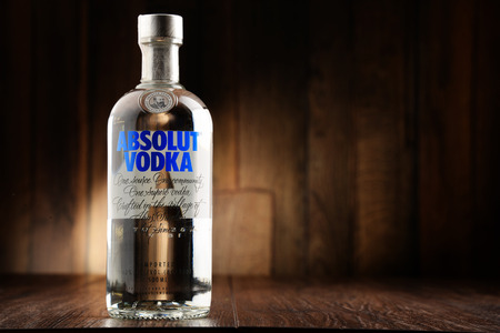 vodka bottle: POZNAN, POLAND - JUNE 22, 2016: Absolut Vodka is a brand of vodka, produced near Ahus, in Sweden. Owned by French group Pernod Ricard it is one of the largest brand of alcoholic spirits in the world.