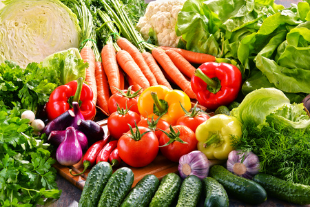 Composition with variety of fresh organic vegetables.