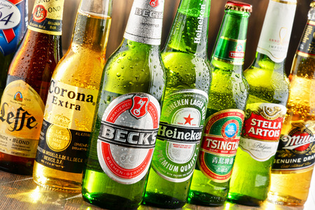largely: POZNAN, POLAND - JULY 14, 2016: beer is the worlds most widely consumed alcoholic beverage; its global market is largely dominated by brands of several multinational corporations Editorial