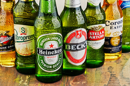 alcoholic beverage: POZNAN, POLAND - JULY 14, 2016: beer is the worlds most widely consumed alcoholic beverage; its global market is largely dominated by brands of several multinational corporations Editorial