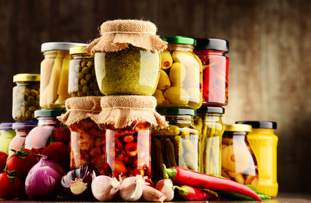 legumbres secas: Jars with variety of pickled vegetables. Preserved food
