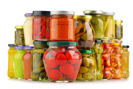 encurtidos: Jars with variety of pickled vegetables. Preserved food