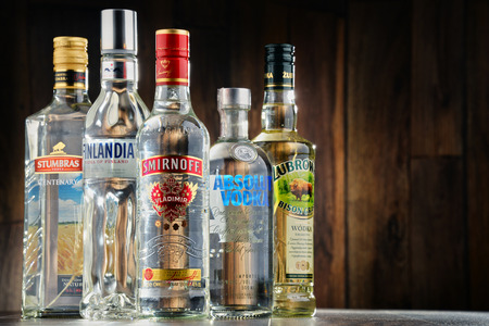 liquors: POZNAN, POLAND - JULY 15, 2016: vodka is the world's largest internationally traded spirit with the estimated sale of about 500 million nine-liter cases a year.