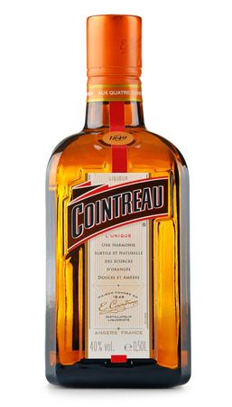 POZNAN, POLAND - JULY 28, 2016: Great component of several well-known cocktails, Cointreau is a brand of French triple sec (an orange-flavoured liqueur). It is also drunk as an aperitif and digestif Editorial