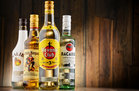 caribbean drink: POZNAN, POLAND - JULY 27, 2016: The Most famous global rum brands come from Caribbean and this is where the beverage originated as a drink made from fermented and distilled sugarcane byproducts