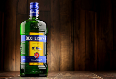 distilled: POZNAN, POLAND - JULY 27, 2016: Becherovka often used as a digestive aid is a an herbal bitters produced in Karlovy Vary, Czech Rep. by the Jan Becher company. Owned by Pernod Ricard.