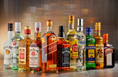 daniels: POZNAN, POLAND - JULY 27, 2016:Worldwide some 2 billion people use alcohol, one of the most widely used recreational drugs on earth, with yearly consumption of over 6 liters of pure alcohol per person