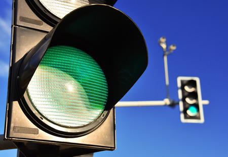 Traffic lights over blue sky. Green light