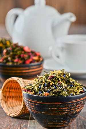 aromatic: Composition with bowls of tea leaves.