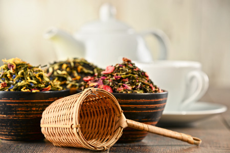 sencha: Composition with bowls of tea leaves.