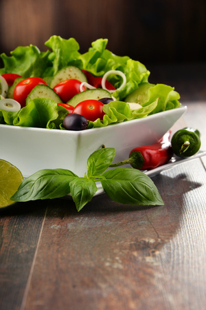 balanced: Composition with vegetable salad bowl. Balanced diet. Stock Photo