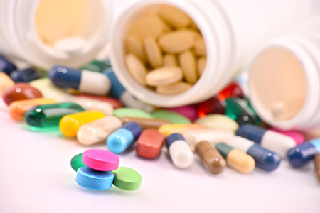 prophylactic: Composition with variety of drug pills and containers. Stock Photo