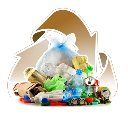 scrapyard: Recyclable garbage consisting of glass, plastic, metal and paper isolated on white