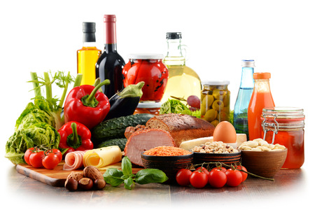 Composition with variety of organic food products isolated on white