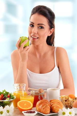 balanced: Young woman having breakfast. Balanced diet. Stock Photo