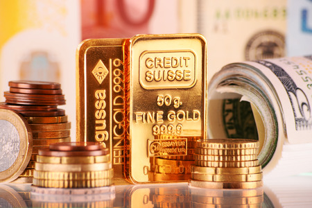 money exchange: POZNAN, POLAND - APR 2, 2015: Gold has been widely used as money. For exchange purposes, mints produce standardized gold bullion coins, bars and other units of fixed weight and purity.