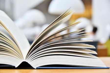 glossary: Hardcover book lying on the table in a library