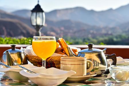 Moroccan breakfast served on hotel terace in Atlas Mountains. Фото со стока