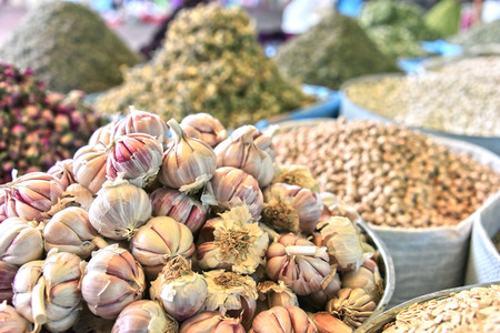 Variety of spices and dried food products on the arab street market stall Stock Photo