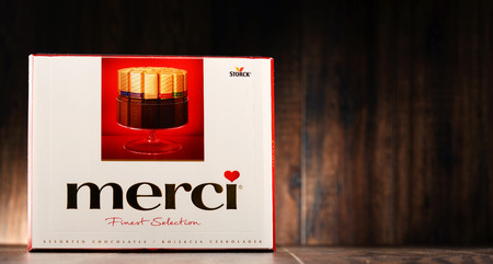 merci: POZNAN, POLAND - OCT 11, 2016: Sold in over 70 countries Merci is a brand of European chocolate candy produced by the German company August Storck KG, headquartered in Berlin