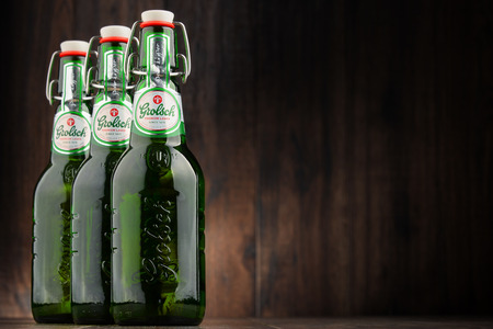 pilsner: POZNAN, POLAND - OCT 12, 2016: Grolsch Premium Pilsner - known internationally as Grolsch Premium Lager, is the flagship beer of Dutch Grolsch Brewery, part of the SABMiller group since 2008 Editorial