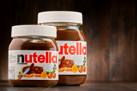nutella: POZNAN, POLAND - OCT 11, 2016: Introduced to the market in 1964 by Italian company Ferrero, Nutella is widely popular brand name of a sweetened hazelnut cocoa spread Editorial