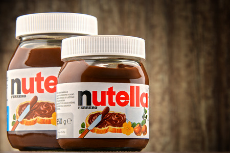 POZNAN, POLAND - OCT 11, 2016: Introduced to the market in 1964 by Italian company Ferrero, Nutella is widely popular brand name of a sweetened hazelnut cocoa spread Editorial
