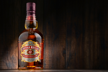 distill: POZNAN, POLAND - OCT 11, 2016: Blended from whiskies matured for at least 12 years Chivas Regal 12 is a blended Scotch whisky produced by Chivas Brothers in Keith, Scotland