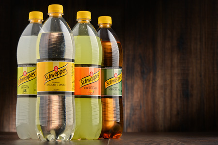 comp: POZNAN, POLAND - OCT 13, 2016: Schweppes Comp. is a beverage manufacturer founded in Geneva and developed in London famed for carbonated soft drinks including ginger ale, bitter lemon and tonic water