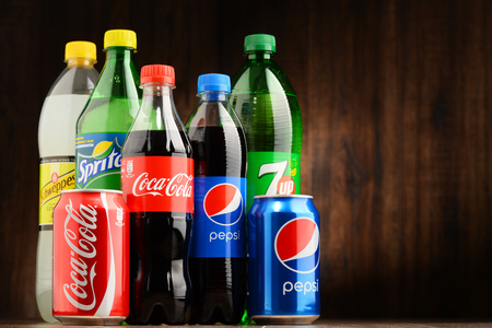 can: POZNAN, POLAND - OCT 13, 2016: Global soft drink market is dominated by brands of few multinational companies founded in North America. Among them are Pepsico, Coca Cola and Dr. Pepper Snapple Group