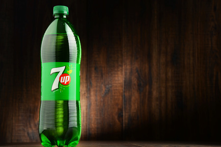 coke bottle: POZNAN, POLAND - OCT 13, 2016: 7 Up is a brand of carbonated soft drink manufactured by Dr Pepper Snapple Group in the US and PepsiCo in the rest of the world. Editorial