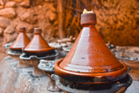 moroccan cuisine: Cooking traditional Moroccan dish, meat and vegetable in  tajine Stock Photo